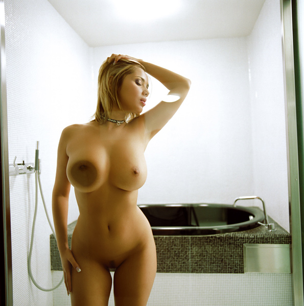 LENKA PUSHING HER BREAST<br>AGAINST THE GLASS