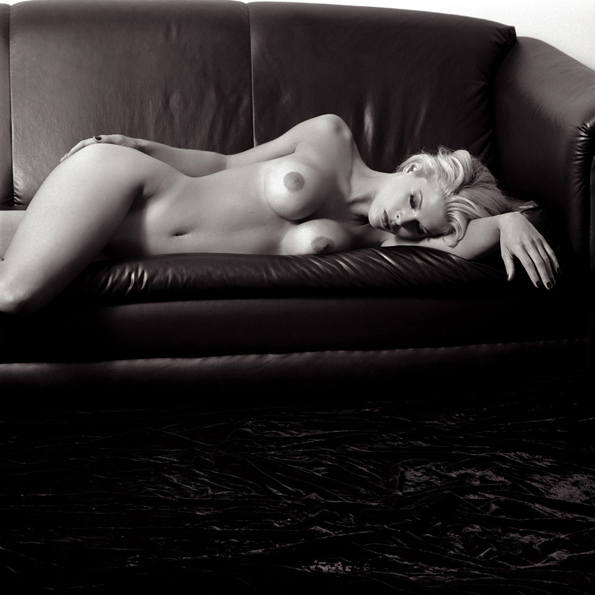 KRISTINE ON A LEATHER COUCH